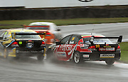 Kayne Scott tries to overtake Eddie Bell on Toyota Corner during the Reverse Grid Race.<br /> BNT V8s Championship at Manfeild Autocourse, Feilding. Sunday 1 March 2009. Photo: Dave Lintott/PHOTOSPORT