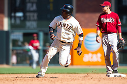 May 30, 2010; San Francisco, CA, USA;  San Francisco Giants shortstop Juan Uribe (5) rounds second base against the Arizona Diamondbacks during the tenth inning inning at AT&T Park.  San Francisco defeated Arizona 6-5 in 10 innings.