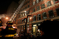 New York CIty Fire Department battle a 5 alarm fire on Broadway at Prince street in Soho Early Sunday Morning January 22nd 2006 photo by Andrew Gombert