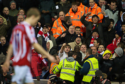 STOKE-ON-TRENT, ENGLAND - Saturday, February 27, 2010: Arsenal supporters hurl abuse at Stoke City's Ryan Shawcross as he walks off after being sent off during the FA Premier League match at the Britannia Stadium. (Photo by David Rawcliffe/Propaganda)