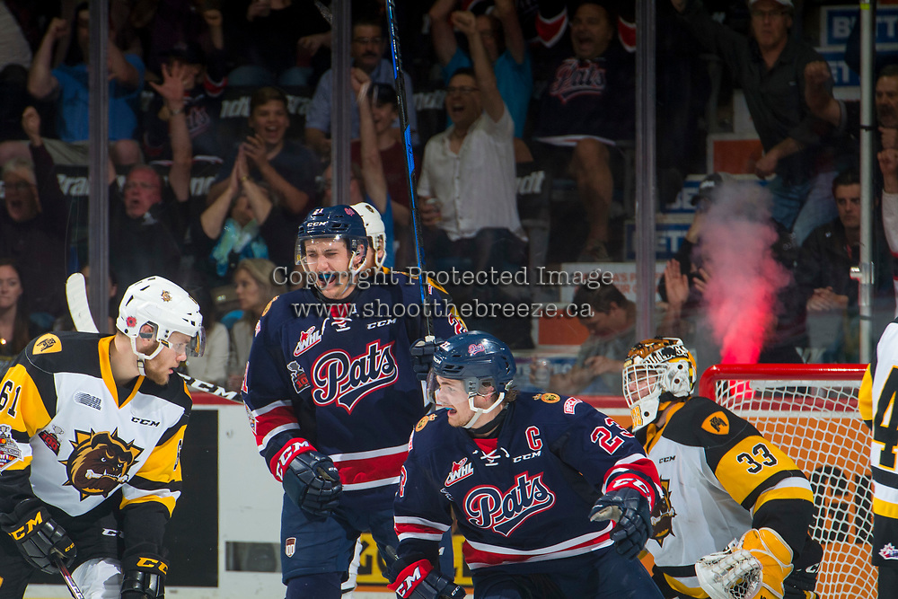 REGINA, SK - MAY 25: Sam Steel #23 and Nick Henry #21 of Regina Pats celebrate a goal against the Hamilton Bulldogs at the Brandt Centre on May 25, 2018 in Regina, Canada. (Photo by Marissa Baecker/CHL Images)