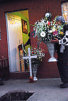 Mexico, Michoacan, Morelia, November 8, 2009. In the capital's working-class neighborhood of Mariano Escobedo, a group of neighbors builds a shrine to the Virgin of Guadalupe right on the street. To Mexico's many faithful, she is a powerful symbol of hope. More at MexicoCulturalCalendar.com