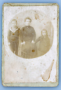 fading vintage photograph of mother with children