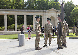© Licensed to London News Pictures. 05/06/2014.  Soldiers rehearse at the British Cemetery in Bayeux this morning ahead of the 70th Anniversary of the D Day landings in Normandy.  Photo credit : Alison Baskerville/LNP
