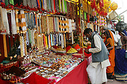 Jewelry market during the Kumbh Mela festival, Ujjain, Madhya Pradesh, India. The Kumbh Mela festival is a sacred Hindu pilgrimage held 4 times every 12 years, cycling between the cities of Allahabad, Nasik, Ujjain and Hardiwar. Kumbh Mela is one of the largest religious festivals on earth, attracting millions from all over India and the world. Past Melas have attracted up to 70 million visitors.
