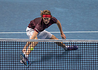 Tennis - 2017 Nitto ATP Finals at The O2 - Day Three<br /> <br /> Group Boris Becker Singles: Roger Federer (Switzerland) Vs Alexander Zverev (Germany)<br /> <br /> Alexander Zverev (Germany) dips low and stretches to reach a Roger Federer (Switzerland) drop shot at the O2 Arena<br /> <br /> COLORSPORT/DANIEL BEARHAM