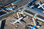 Nederland, Noord-Holland, Haarlemmermeer, 11-12-2013; luchthaven Schiphol. Stationsgebouw en aan de gates geparkeerde vliegtuigen van onder andere KLM.<br /> Schiphol Airport with terminal building and at the gates of parked aircraft, amongst others KLM.<br /> luchtfoto (toeslag op standard tarieven);<br /> aerial photo (additional fee required);<br /> copyright foto/photo Siebe Swart
