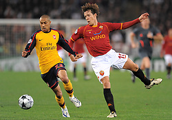 Gael Clichy and Rodrigo Taddei compete for the ball during the UEFA Champions League, Round of Last 16, Second Leg match between AS Roma and Arsenal at the Stadio Olimpico on March 11, 2009 in Rome, Italy.