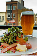 Beet Salad composed of roasted beets, arugula, champagne granita, rhubarb, cherry Glenn goat cheese.