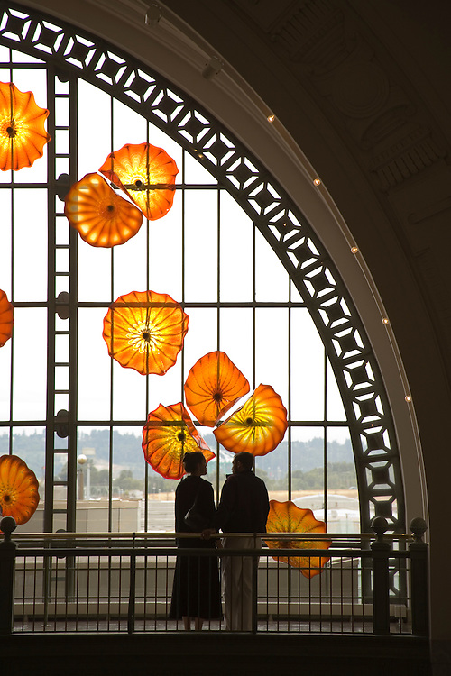 Couple looking through Monarch Window of glass art by Dale Chihuly, Union Station, Tacoma, Washington, USA