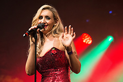 © Licensed to London News Pictures . 07/11/2015 . Manchester , UK . Actress CATHERINE TYLDESLEY sings ahead of the Christmas Lights switch on at Albert Square in front of Manchester Town Hall . Photo credit : Joel Goodman/LNP