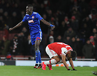 Football - 2019 / 2020 UEFA Europa League - Round of Thirty-Two, Second Leg: Arsenal (1) vs. Olympiakos (0)<br /> <br /> A dejected Pierre - Emerick Aubameyamg of Arsenal, drops to his knees at the final whistle as Ousseynou Ba celebrates at the Emirates Stadium.<br /> <br /> COLORSPORT/ANDREW COWIE