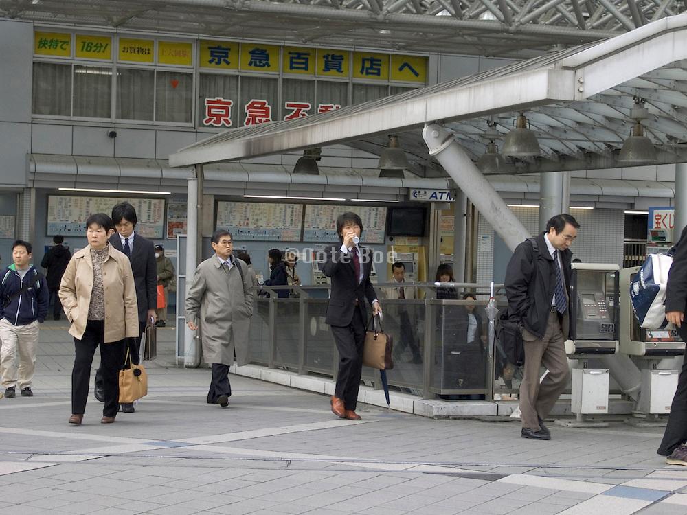 commuters outside the train station in Yokosuka City