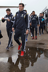 CARDIFF, WALES - Saturday, November 15, 2014: Wales' Gareth Bale and the squad arrive at Cardiff Airport for their flight to Brussels ahead of the UEFA Euro 2016 Qualifying Group B game against Belgium. (Pic by David Rawcliffe/Propaganda)