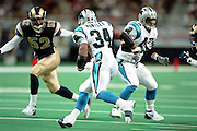 Running Back Richard Huntley (34) of the Carolina Panthers runs toward Linebacker Tommy Polley (52) of the St. Louis Rams during a 48 to 14 win by the Rams on 11/11/2001..©Wesley Hitt/NFL Photos