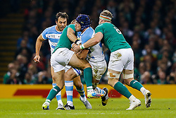 Argentina Lock Guido Petti Pagadizaval is tackled by Ireland Fly-Half Ian Madigan and Number 8 Jamie Heaslip (capt) - Mandatory byline: Rogan Thomson/JMP - 07966 386802 - 18/10/2015 - RUGBY UNION - Millennium Stadium - Cardiff, Wales - Ireland v Argentina - Rugby World Cup 2015 Quarter Finals.