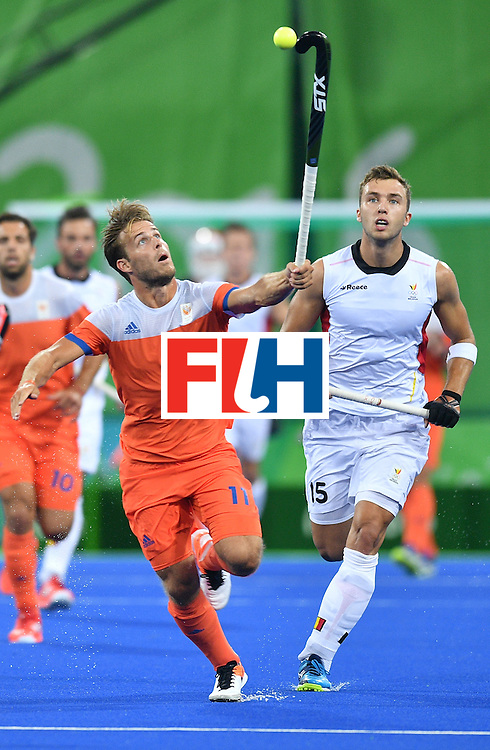 Netherland's Jeroen Hertzberger (L) vies with Belgium's Emmanuel Stockbroekx during the men's semifinal field hockey Belgium vs Netherlands match of the Rio 2016 Olympics Games at the Olympic Hockey Centre in Rio de Janeiro on August 16, 2016.  / AFP / Carl DE SOUZA        (Photo credit should read CARL DE SOUZA/AFP/Getty Images)