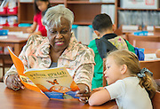 Retired teacher Loretha Fore reads with students as part of the Read Houston Read program at Southmayd Elementary School, April 7, 2015.