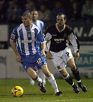 Photo: Olly Greenwood.<br />Colchester United v Hull City. Coca Cola Championship. 28/11/2006. Colchester's Pat Baldwin and Hull's Stuart Elliott