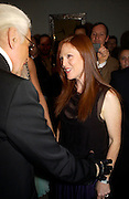 Karl Largerfeld and Julianne Moore. Karl Largerfeld hosts the launche of Dom Perignon Vintage 1998. Skylight Studios. 275 Hudson St. New York. 2 June 2005. ONE TIME USE ONLY - DO NOT ARCHIVE  © Copyright Photograph by Dafydd Jones 66 Stockwell Park Rd. London SW9 0DA Tel 020 7733 0108 www.dafjones.com
