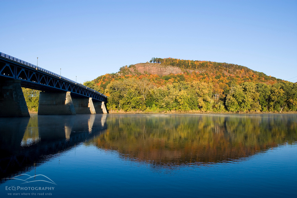 The Connecticut River, State Route 43 bridge, and South Sugarloaf Mountain as seen from the east bank of the river in Sunderland, Massachusetts.
