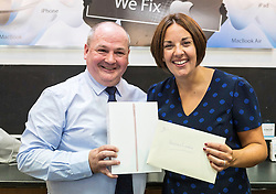 Scottish Labour Leader, Kezia Dugdale, visits IT repair and retail store SimplyFixIt in Edinburgh, which has recently been accredited as a living wage employer.<br /> <br /> Pictured: Kezia Dugdale with Scott Wilkinson (Area Manager) who had presented Kecia with an engagement present from SimplyFixIt