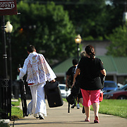 """Taylor Rodriguez walks away after a performance in downtown Bedford, Va.  """"People think he's ad-libbing. They don't think he's doing this. But he is,"""" said Donna Robriquez, Taylor Robriguez's mother."""