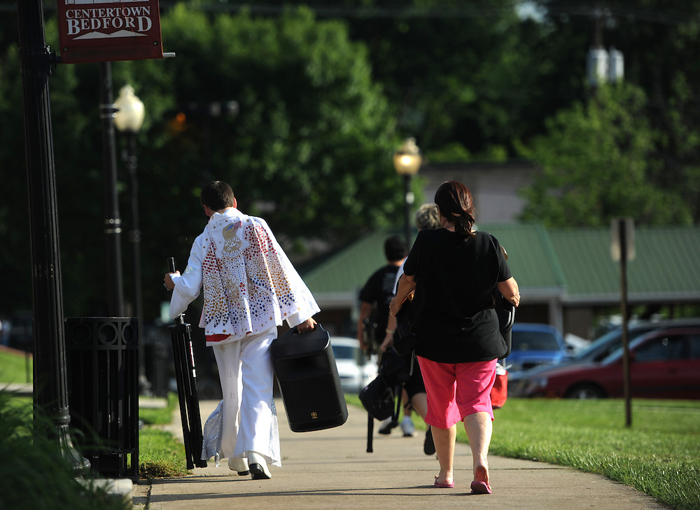 "Taylor Rodriguez walks away after a performance in downtown Bedford, Va.  ""People think he's ad-libbing. They don't think he's doing this. But he is,"" said Donna Robriquez, Taylor Robriguez's mother."