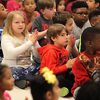 Kaylee Reynolds, a first grader at Thomas Street Elementary School, applauds with her classmates during the announcement of a $34,408.00 grant from the Lowe's Gives Foundation on Friday morning. Michelle Guyton, Art teacher at Thomas Street Elementary, wrote the grant for the play to learn project that will place two new playgrounds at the school that will transform an unused area into an inviting learning enviroment for all students.