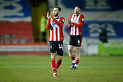 Jorge Grant of Lincoln City and Cian Bolger of Lincoln City applauds the fans at full time during the EFL Sky Bet League 1 match between Lincoln City and Portsmouth at Sincil Bank, Lincoln, United Kingdom on 28 January 2020.