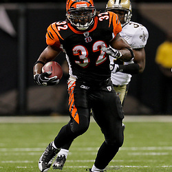 2009 August 14: Cincinnati Bengals running back Cedric Benson (32) runs away from New Orleans Saints safety Pierson Prioleau (31) during a preseason opener between the Cincinnati Bengals and the New Orleans Saints at the Louisiana Superdome in New Orleans, Louisiana.