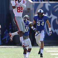 Lauren Wood | Buy at photos.djournal.com<br /> Ole Miss wide receiver Cody Core pulls down a pass while loosely defended by Memphis defensive back Arthur Maulet during Saturday's game at Memphis.