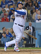 Los Angeles Dodgers catcher Yasmani Grandal #9 winced after a swing and a miss in the 5th inning, but on the next pitch he put the ball in the right field bleachers for a solo home run. The Los Angeles Dodgers played the Cincinnati Reds at Dodger Stadium in Los Angeles , CA.  May 25, 2016. (Photo by John McCoy/Southern California News Group