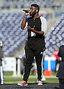 Singer Trevin Hunte sings the National Anthem as he practices before the San Diego Chargers NFL week 15 regular season football game against the Denver Broncos on Sunday, Dec. 14, 2014 in San Diego. The Broncos won the game 22-10. ©Paul Anthony Spinelli
