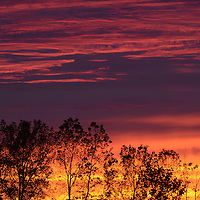 Laura Stoecker/lstoecker@dailyherald.com<br /> A fiery sunset lights up the horizon after severe weather passed through the area.