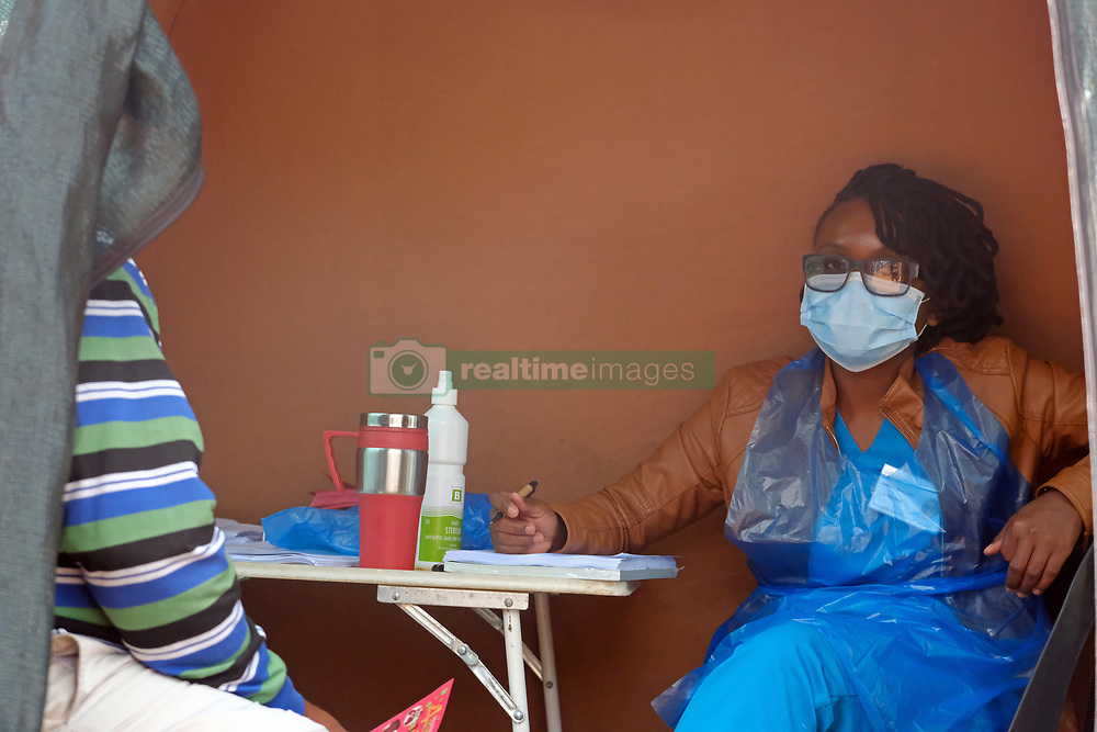 KRUGERSDORP, SOUTH AFRICA - APRIL 08: Health officials assist members of the public at a Covid19 screening centre in the Munsieville suburb on April 08, 2020 in Krugersdorp, Mogale South Africa. Under pressure from a global pandemic. President Ramaphosa declared a 21 day national lockdown, mobilising goverment structures accross the nation to combat the rapidly spreading COVID-19 virus, or Coronavirus. The lockdown requires businesses to close and the public to stay at home during this period, unless part of approved essential services.(Photo by  Dino Lloyd)