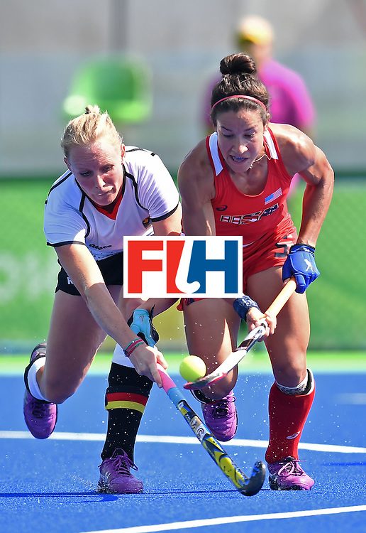 Germany's Hannah Kruger (L) vies with The USA's Melissa Gonzalez during the women's quarterfinal field hockey USA vs Germany match of the Rio 2016 Olympics Games at the Olympic Hockey Centre in Rio de Janeiro on August 15, 2016. / AFP / MANAN VATSYAYANA        (Photo credit should read MANAN VATSYAYANA/AFP/Getty Images)