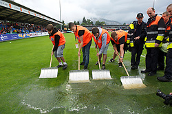 ALTACH, AUSTRIA - Saturday, July 17, 2010: Workers frantically try to remove water from the pitch with snow shovels before Liverpool's first preseason match of the 2010/2011 season  against Al-Hilal Al Saudi FC at the Cashpoint Arena. (Pic by David Rawcliffe/Propaganda)