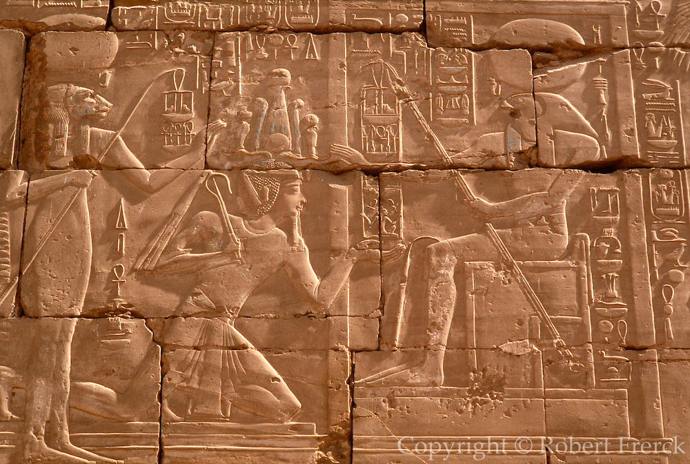 EGYPT, ANCIENT MONUMENTS, KARNAK Temple of Amun; the Great Hypostyle Hall with a relief of Seti I kneeling before Ra the Sun god