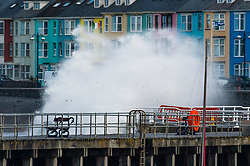 © Licensed to London News Pictures. 28/07/2018. Aberystwyth, UK. Gale force winds and huge tides combine to bring huge waves crashing into the harbour wall in Aberystwyth on the west Wales coast, as the long heatwave finally breaks down with thunderstorms and torrential rain over much of the country. photo credit: Keith Morris/LNP