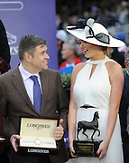 Juan-Carlos Capelli, VP and Head of International Marketing, Longines, talks with model and actress Kate Upton in the Winner's Circle after American Pharoah wins the Breeders' Cup Classic at Keeneland Racecourse on Saturday, Oct. 31, 2015 in Lexington, KY.  Longines, the Swiss watch manufacturer known for its elegant timepieces, is the Official Watch and Timekeeper of the Breeders' Cup World Championships and the Triple Crown. (Photo by Diane Bondareff/Invsion for Longines/AP Images)