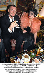 Designer ALEXANDER MCQUEEN and ISABELLA BLOW. at a party in London on 4th May 2004.PTT 140
