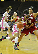 February 16 2011: Iowa Hawkeyes guard Kachine Alexander (21) tries to drive around Wisconsin Badgers guard Taylor Wurtz (2) during the first half of an NCAA women's college basketball game at Carver-Hawkeye Arena in Iowa City, Iowa on February 16, 2011. Iowa defeated Wisconsin 59-44.