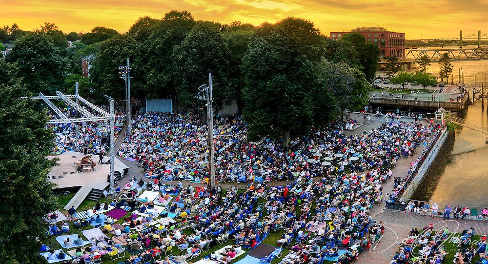 An overview of the Prescott Park Arts Festival scene in Portsmouth, NH, at sunset during a concert by Judy Collins in August, 2013