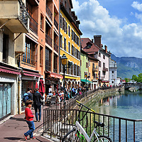 Little Boy Running Near Thiou in Annecy, France<br /> This little French boy with a red sweater and matching tennis shoes ran eagerly on the Quai de I'Ile towards the Thiou Canal in Annecy, France. Immediately after the photo was taken, he dangled over the railing and searched the river for fish. Despite all of the magnificent Medieval buildings around him in the Old Town, he was disappointed when he didn't find anything swimming below.