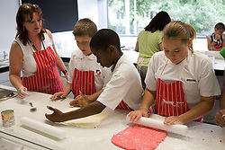 Students rolling out fondant in Food Studies lesson during their induction day,
