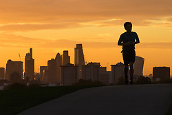 Primrose Hill, London, September 27th 2016. A runner's silhouette on Primrose Hill breaks the city skyline as a new day dawns over London. &copy;Paul Davey<br /> FOR LICENCING CONTACT: Paul Davey +44 (0) 7966 016 296 paul@pauldaveycreative.co.uk