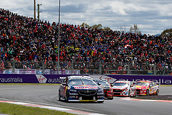 October 7, 2018 - Bathurst, NSW, U.S. - BATHURST, NSW - OCTOBER 07: Jamie Whincup / Paul Dumbrell in the Red Bull Holden Racing Team Holden Commodore leads a pack of cars out of turn one at the Supercheap Auto Bathurst 1000 V8 Supercar Race at Mount Panorama Circuit in Bathurst, Australia. (Photo by Speed Media/Icon Sportswire) (Credit Image: © Speed Media/Icon SMI via ZUMA Press)