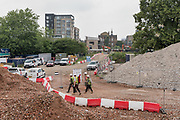 London, England, UK, May 31 2018 - Demolition and construction work undergoinga at Aylesbury Estate, a housing estate in Walworth, South East London. Water leaks have already appeared in some of the new buildings (rear left) build in 2015.<br /> Aylesbury Estate, once the largest estate in Europe, is currently undergoing a major regeneration programme by demolishing and replacing of the dwellings with modern houses controlled by a housing association. Some residents and activists still protest against the demolition and the gentrification of London.<br /> London is facing a major housing crisis, due to rising cost and under-supply.