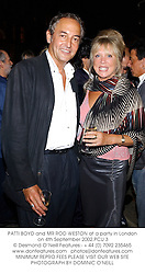 PATTI BOYD and MR ROD WESTON at a party in London on 4th September 2002.	PCU 3